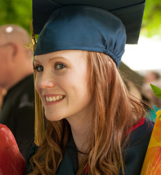 Photo of graduate outside