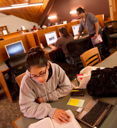 Photo of student in Bedford Campus library
