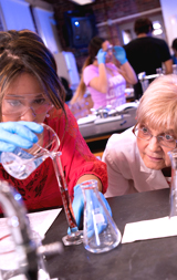 Photo of inststructor with student in science lab