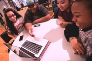 Photo of students working together