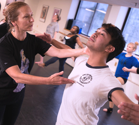 MCC instructor and student in a modern dance class