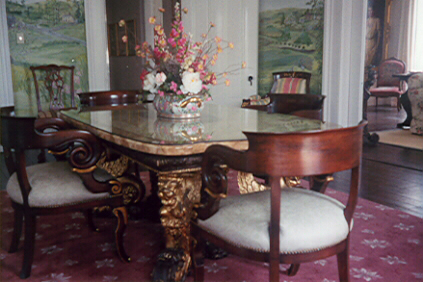 Dining table in round room at Nesmith House