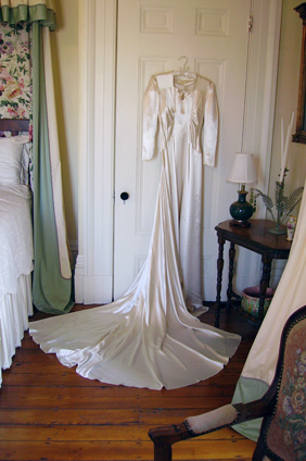 Photo of wedding dress in bedroom