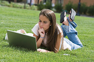 Student outside on computer