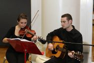 Photo of students playing violin and guitar