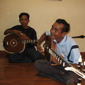 Men playing string instruments Cambodia