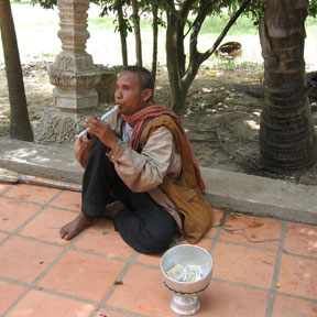 Man playing flute in cambodia